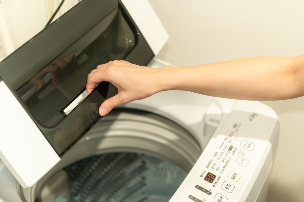 洗濯機 手